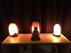 Salt lamps and Budda in our Infrared Sauna room